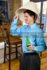 Man drinking adult beverages at a party wearing a lampshade
