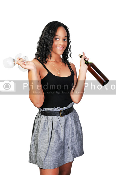 A beautiful African American woman holding wine
