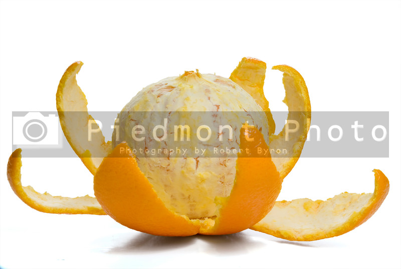 An Orange with the skin sliced into sections