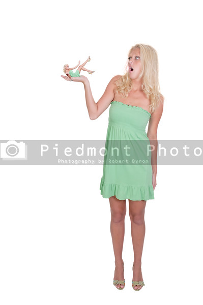 A young Beautiful Woman holding herself in thepalm of her hand