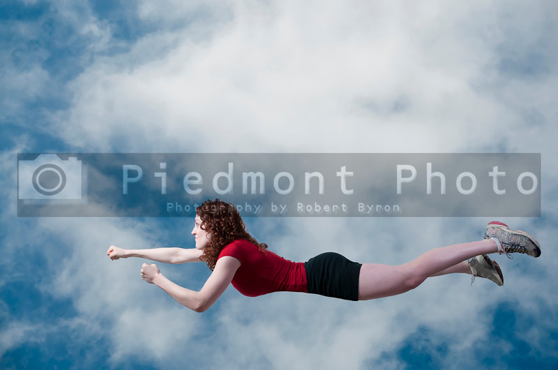 A beautiful young woman flying through the sky