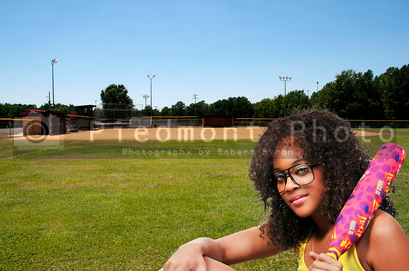 A young woman ready to play baseball