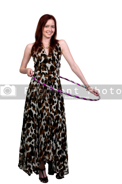 A beautiful woman using the ever popular hula hoop