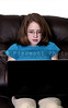 A beautiful computer savvy young teenager using a laptop