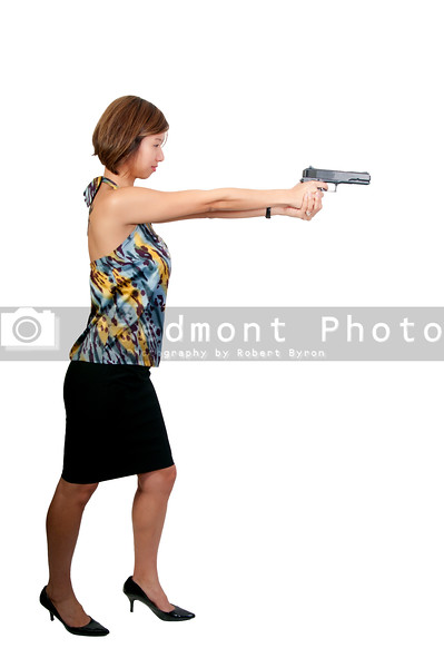 A beautiful Asian female police detective woman on the job with a gun