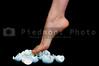 A woman in high heels walking on eggshells