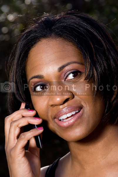 An African American woman talking on a cell phone