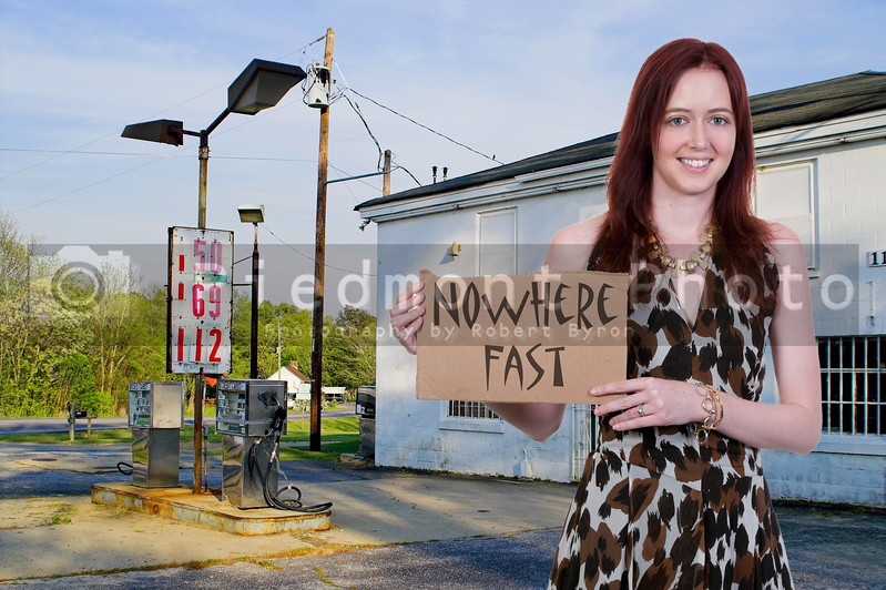 A beautiful woman with a sign who is going nowhere fast