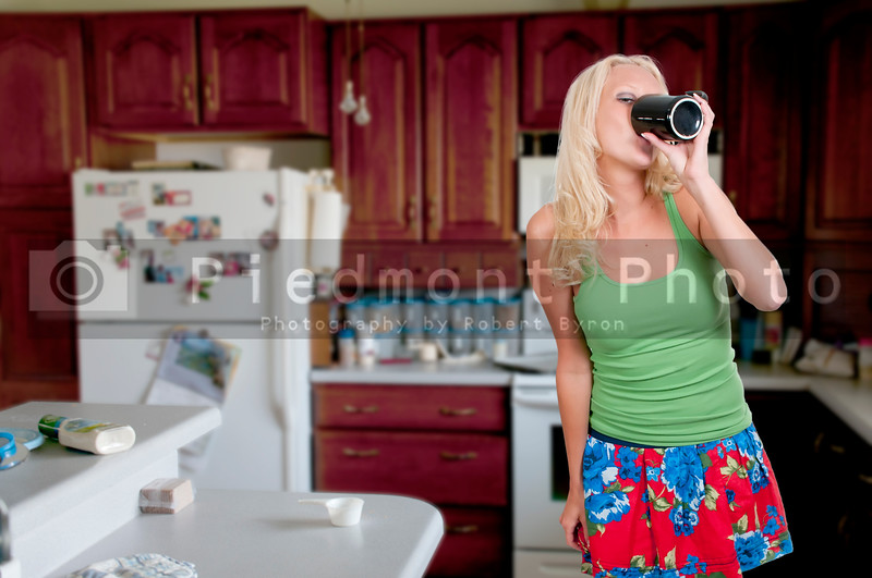 A beautiful young woman drinking coffee in the morning
