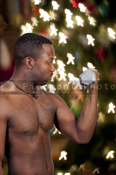 A black African American man lifting a weight