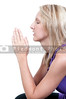 Beautiful Christian woman in a deep prayer