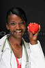 A beautiful female doctor holding a heart