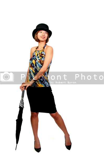 A beautiful young Asian actress dancer wearing a top hat