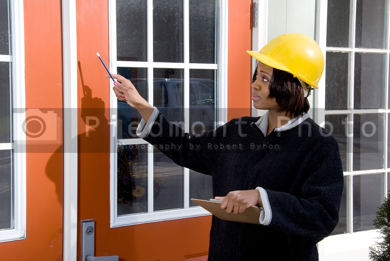 A female construction worker inspecting a building