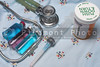 Medical gown, stethoscope, syringe, pills and vial.