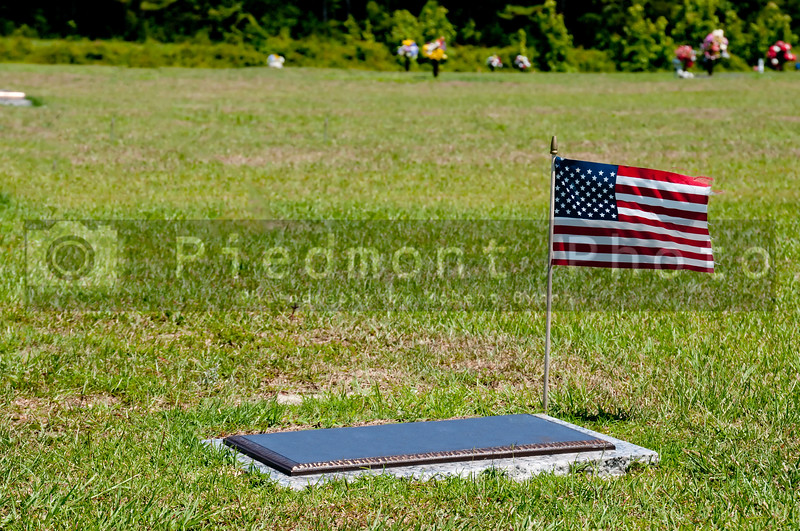 A military grave with a small American flag.