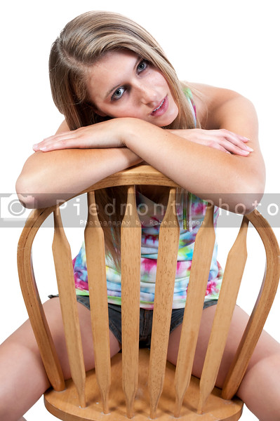 A beautiful sexy young woman sitting in a chair