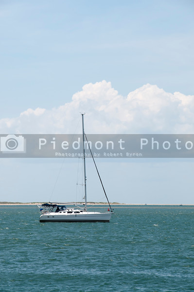 A sailboat moored off the shore of the ocean