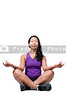 A beautiful Asian woman doing her Yoga lotus position execises