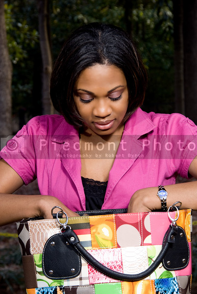 An African American woman going trough her purse