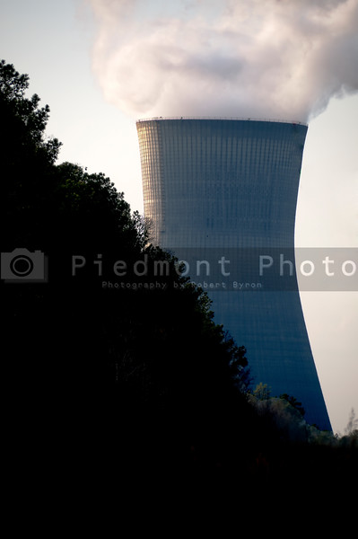 View of a nuclear power plant with high tension wires.