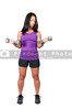 A beautiful young Asian woman using weights during a workout