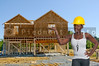 Black woman African American constuction worker in front of house being built