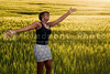 An allergy free african american black woman in a field of winter wheat