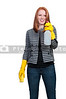 A glove wearing beautiful woman or maid cleaning house with a sponge and spray bottle with cleaner