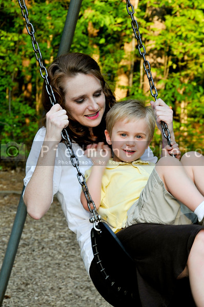 A mom and her son on a swing