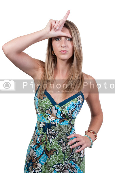A woman making the loser sign with her hand