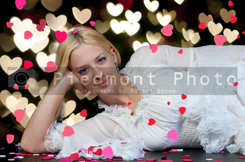 A beautiful young blond woman on Valentine's day.