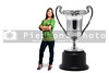 A beautiful hispaniv woman standing beside a silver championship cup, sports trophy award.