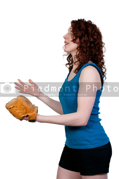 A beautiful woman waiting to catch a baseball