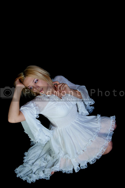 A young Beautiful Woman in a white dress