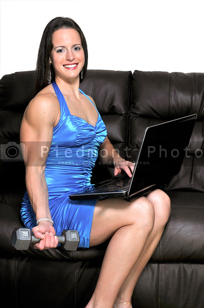 A woman using a computer while working out