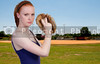 A beautiful woman pitcher getting ready to throw a ball