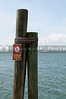 No jumping or diving sign on a dock by the ocean