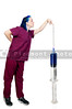 A medical doctor or nurse in scrubs preparing an injection in a giant syringe