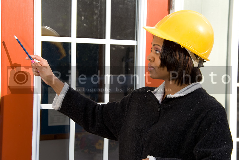 A Construction Supervisor inspecting a new building