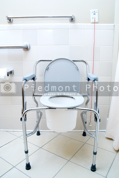 A Portable Toilet in a hospital patients latrine.