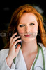 A beautiful female doctor on the phone.