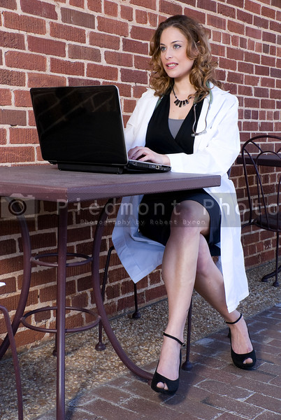 A female doctor working on a laptop computer
