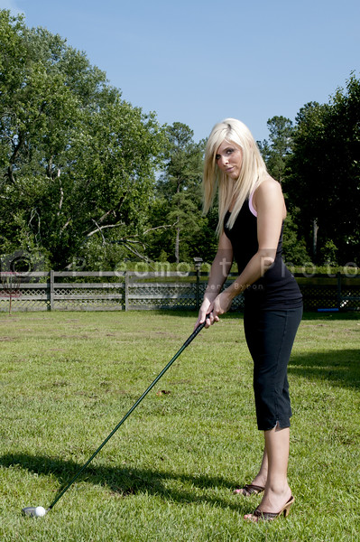 A very beautiful and young female golfer