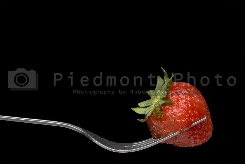 A fresh and delicious Strawberry on a Fork