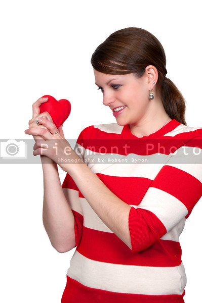 A beautiful young woman holding a Valentines Day heart