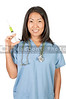 A young beautiful Asian woman doctor in scrubs with a medical syringe with medicine