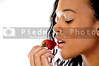 An African American woman Eating a Strawberry