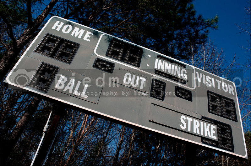 A Baseball Scoreboard at a local league field