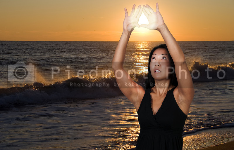 A beautiful young Asian woman hanging the sunset